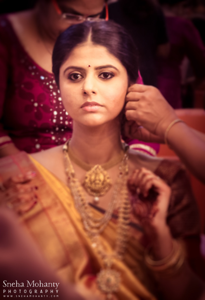 Getting ready shot of malayali bride